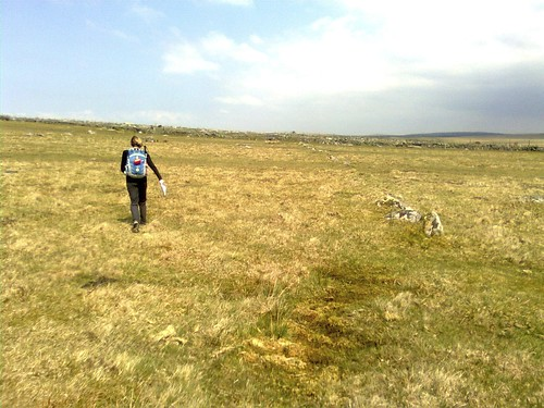Wendy striding ahead towards Candra - Mile 16