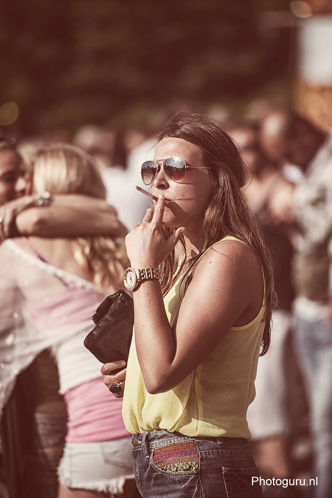 girl smoking cigarette during the festival