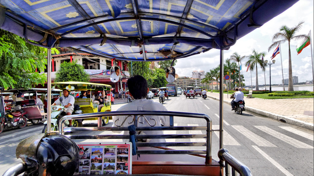 Tuk tuk ride along the Phnom Penh riverwalk