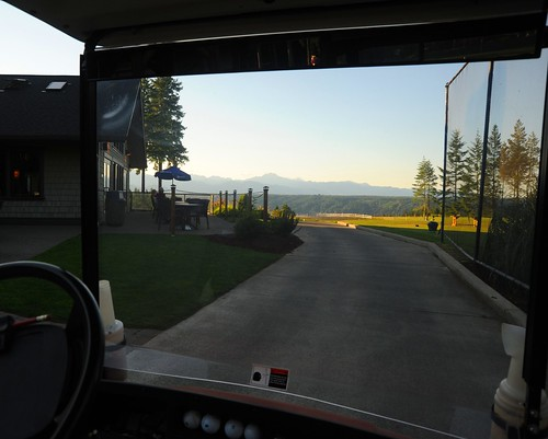 Framing a view of the Olympic Mountains from my auntie's golfcart, golf ball screen, Alderbrook Golf Course, Union, Washington, USA by Wonderlane