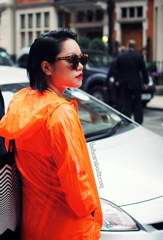 Orange raincoat streetstyle lfw