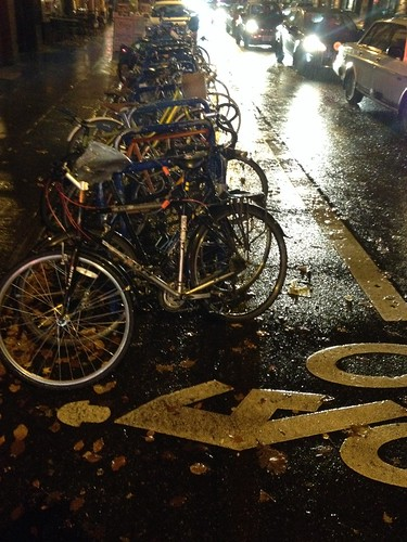 Rainy Bike Corral Stuffed With Bikes