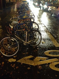 Rainy Bike Corral Stuffed With Bikes
