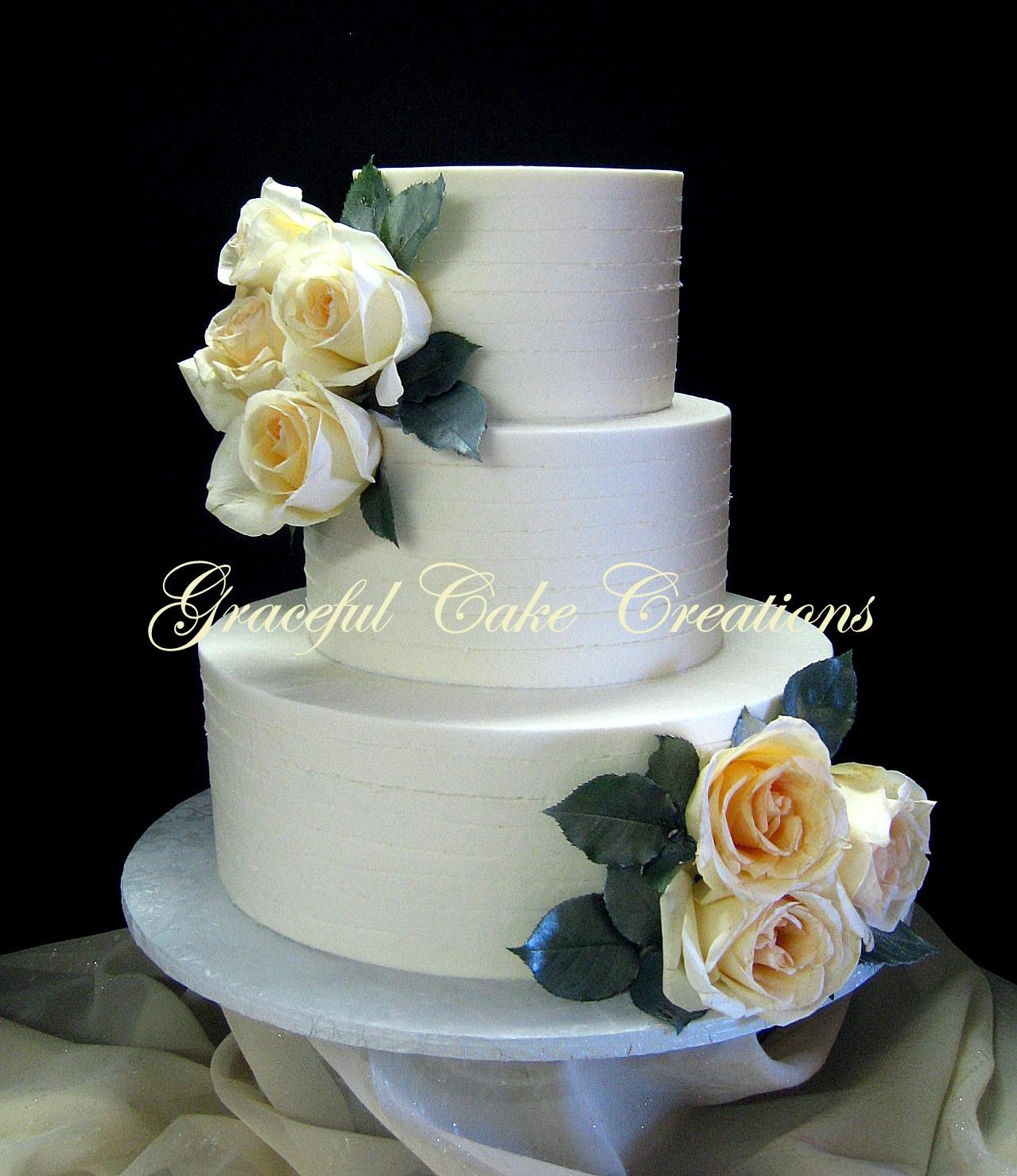 Elegant Ivory Butter Cream Wedding Cake with Vintage Roses