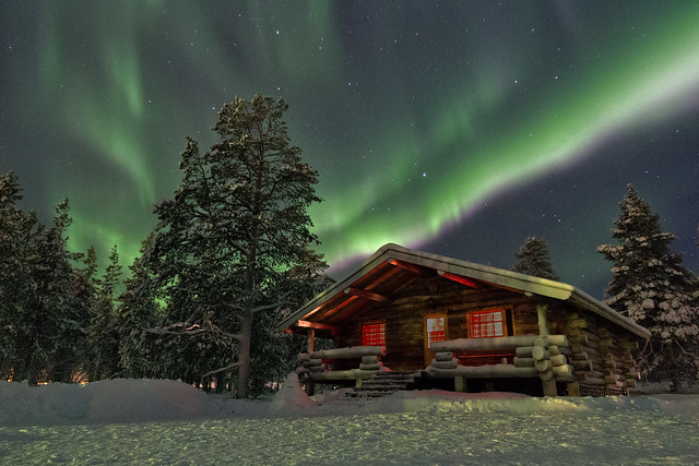 Northern lights above a cottage