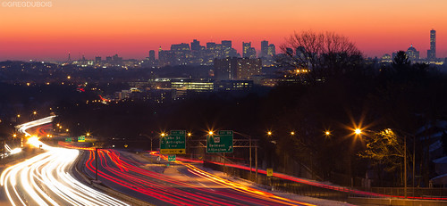 Route 2 Light Trails with Boston Skyline and Suburbs during Pink Sunrise, Arlington MA by Greg DuBois Photography