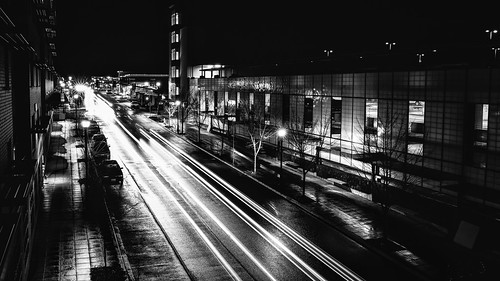 issaquah highlands blackandwhite longexposure raining contrast traffic street highlandsdr night canon canoneos5dmarkiii sigma35mmf14dghsmart johnwestrock washington