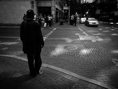 Waiting to cross #monochromephoto #monochrome #blackandwhitephoto #blackandwhitephotography  #streetphotography #urbanlandscape #urbanphotography #sanantonio #satx