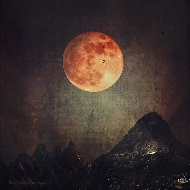 moon over dark mountains