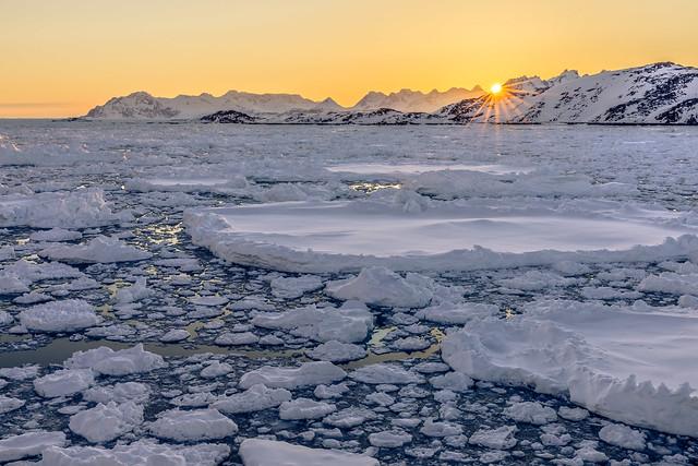 sunset over drift ice
