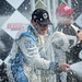 Simon Pagenaud sprays champagne on the podium