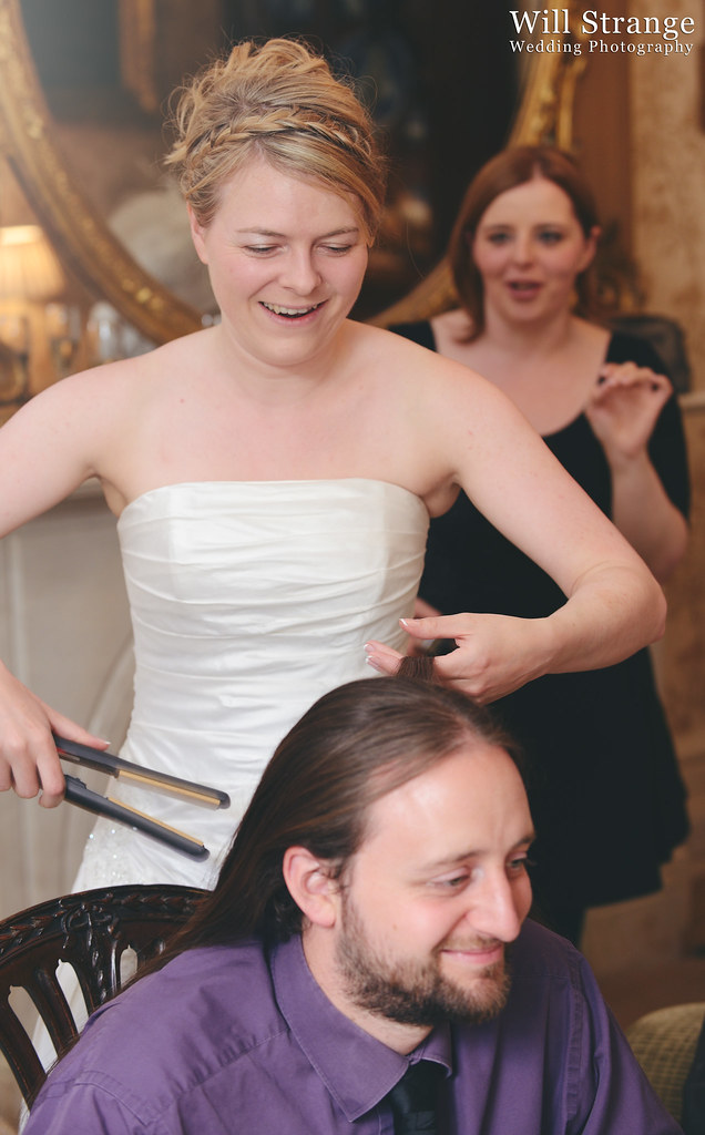Ruth straightening guest's hair