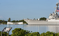 The guided-missile destroyer USS Halsey (DDG 97) conducts a pass-in-review by the USS Arizona Memorial during the 72nd Anniversary Pearl Harbor Day Commemoration ceremony. (U.S. Navy photo by Mass Communication Specialist 3rd Class Diana Quinlan)