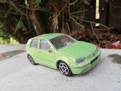 automobile(1.0), wheel(1.0), volkswagen(1.0), vehicle(1.0), volkswagen golf mk4(1.0), subcompact car(1.0), city car(1.0), land vehicle(1.0), hatchback(1.0), volkswagen golf(1.0),