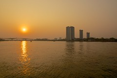 Sunset seen from Asiatique - The riverfront by the Chao Phraya river in Bangkok, Thailand