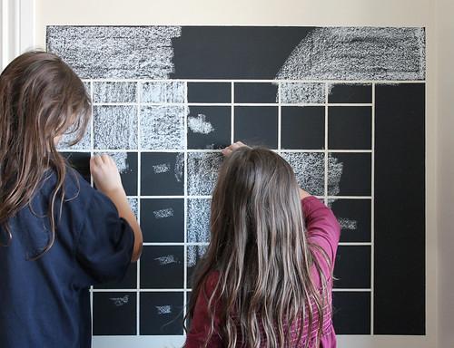 girls prepping the chalkboard calendar