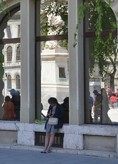 Sitting at the base of the statue.  University Square, Bucharest