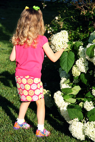 Autumn-checking-out-hydrangea-bush