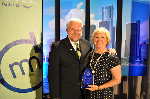 Former Troy Councilmember Robin Beltramini Accepts Honorary Life Membership Award from Michigan Municipal League President David Lossing at Annual Convention in Detroit 2013