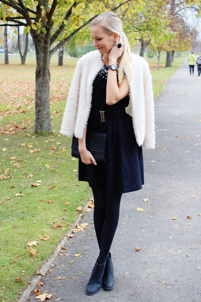 faux fur white jacket, high waisted belt skirt, chelsea akle boots, black clutch from H&M