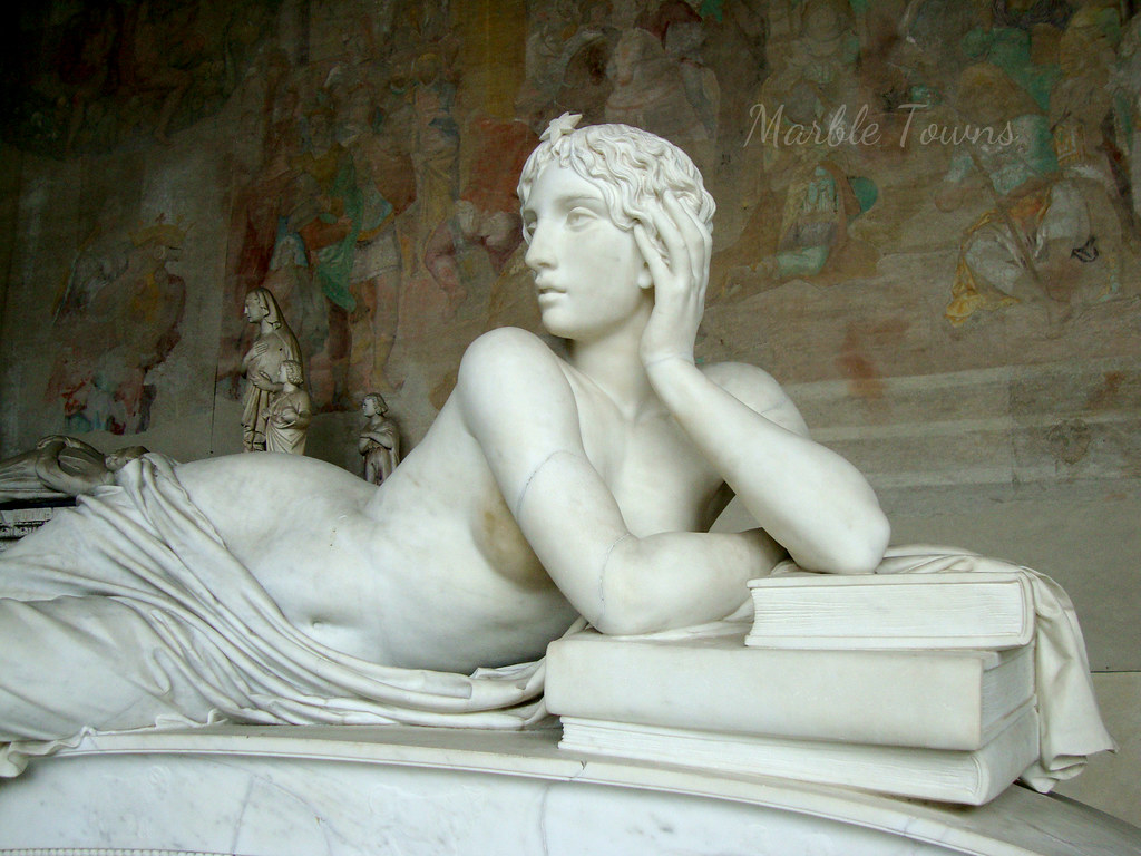 Camposanto Cemetery-statue of woman leaning on books 1