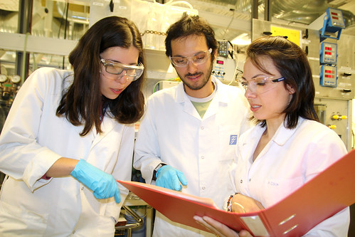 three chemical engineers collaborate