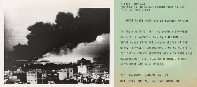 VIETNAM WAR PHOTO - SMOKE RISES OVER BATTLE SCARRED SAIGON