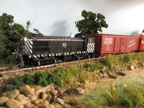 A Bachman H.O Scale Alco S 4 yard switcher, leads an Atchison, Topeka & Santa Fe Railroad switching local from the 1950's and 60's era. by Eddie from Chicago