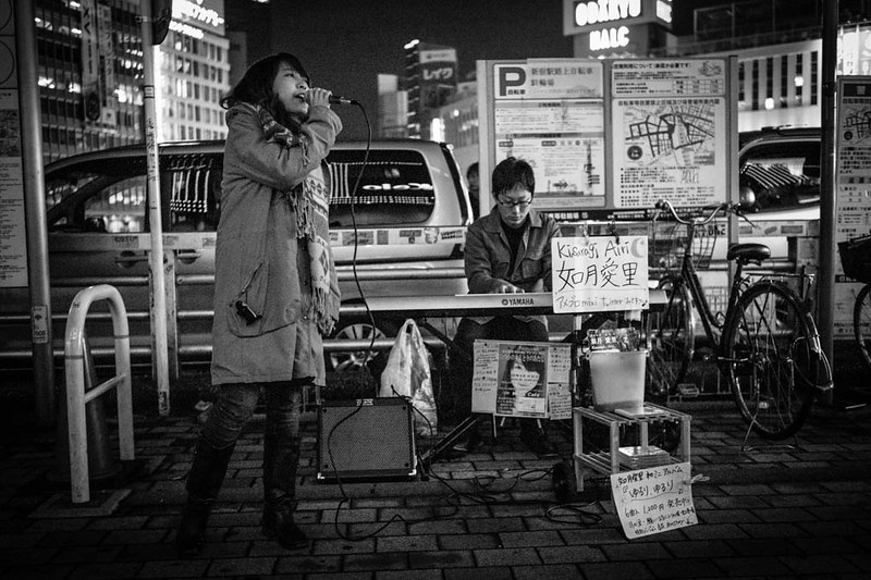 A busker singing near Shinjuku station.