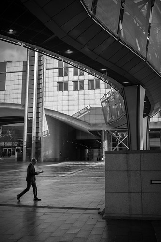 Outside the European Union in Brussels. I liked the shadow and shapes created by this overhead walkway, so I waited until a person walked by. Timing is key and if I waited for the subject to take one more step this would have been a stronger image.