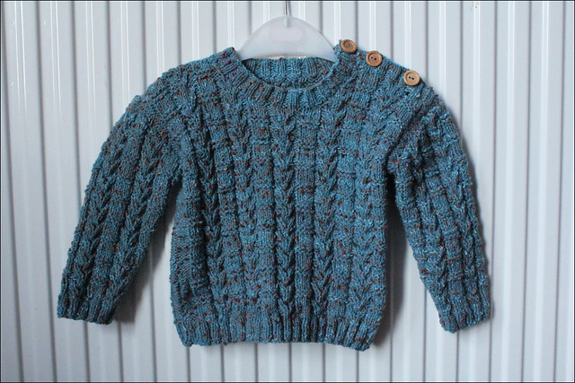 blue cabled baby jumper
