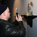 """Steven photographing Julie Zarate's sculpture """"The Magician"""" by lastritestattoo"""