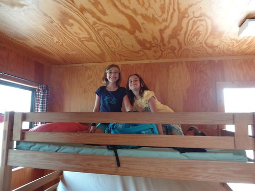 Mimi and Audrey on the top bunk