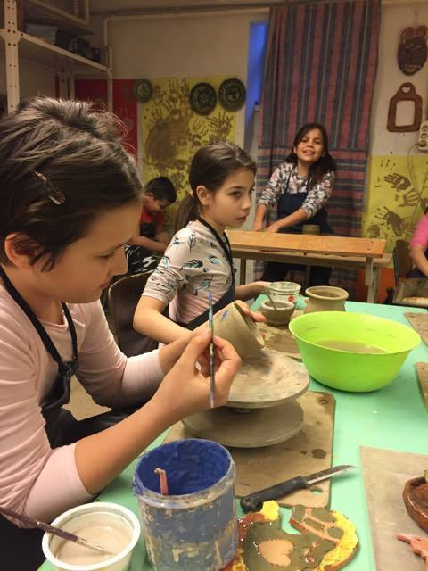 painting the finished cray pottery