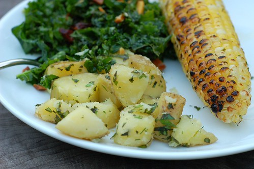 Herby grilled corn with steamed potatoes in herbed butter and massaged kale salad by Eve Fox, the Garden of Eating blog, copyright 2013