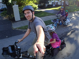 family of four biking to dinner