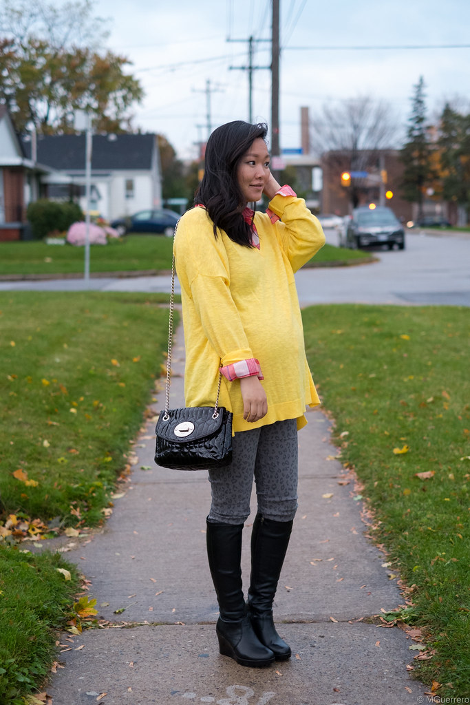 yellow oversized vneck sweater, plaid red white shirt, animal print jeggings, tall wedge boots