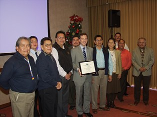 USDA Rural Development New Mexico State Director Terry Brunner (center) presents a certificate of obligation to the Ten Southern Pueblo Council Governors and representatives during ceremonies to celebrate the successful application of funds creating the first ever Native American Food Hub in the nation. (USDA Photo)