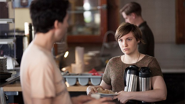 Hannah from Girls looks angry in a cafe