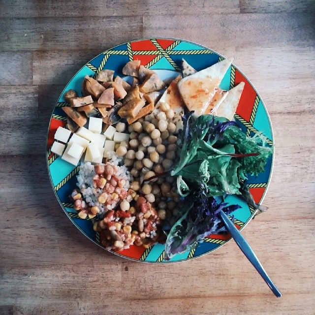 Served up a bit too much, but here is my colourful dinner tonight : sweet chilli chickpeas, leafy greens, crispy tofu, roast sweet potato, cheese cubes, left over brown  rice & beans.