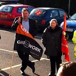 John Cruddas with a GMB flag at the Protest to save Pensions outside the Civic Centre, Dagenham, November 2011.