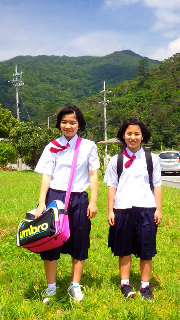 TWO OF THE MANY YOUNG GIRLS WHO HAVE CONQUERED SAAFAJI MOUNTAIN ABOVE SHIOYA BAY in NORTHERN OKINAWA