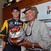 Graham Rahal and Jack Hanna show off Graham's helmet to be auctioned off