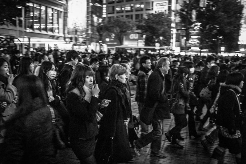 Putting on lipstick while crossing the road. Shibuya, Tokyo