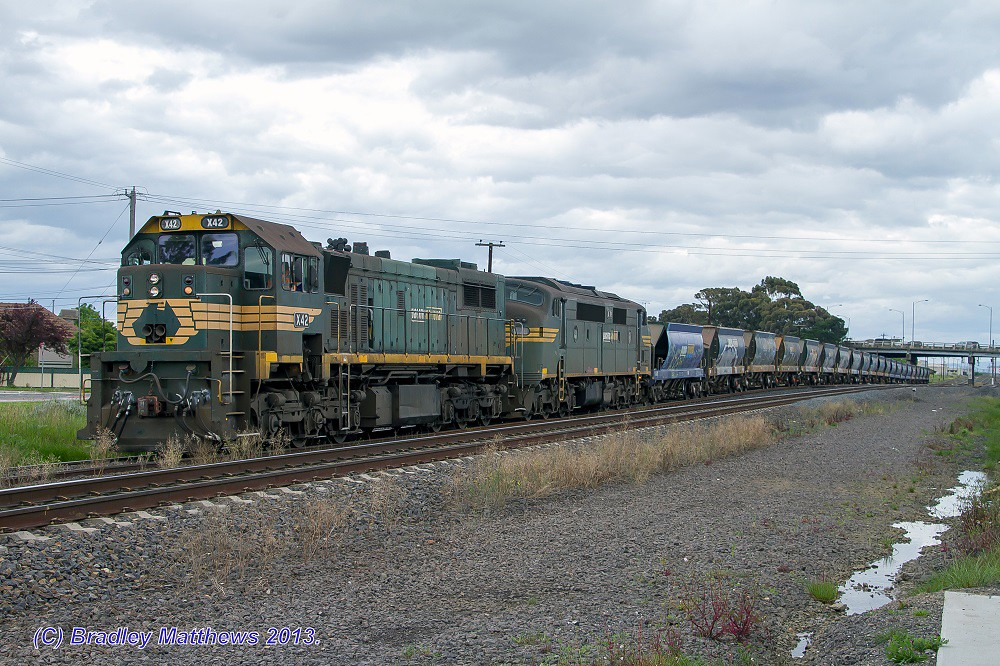 X42-A78 with #9318 Hansons Quarry Apex train at Albion (24/9/2013) by Bradley Matthews