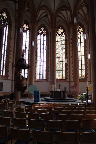inside view of church   with stained glass windows