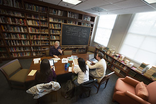 Professor Hans Rindisbacher works with his Advanced German class