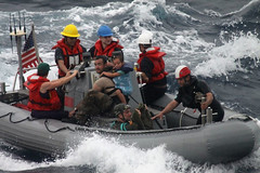 Sailors from USS Vandegrift (FFG 48) assist in the rescue of a family with a sick infant, April 6. (U.S. Coast Guard photo)