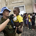 MINUSTAH Peacekeepers Gives Young Flood Victim Water