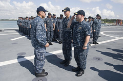 Cmdr. Douglas Meagher salutes Capt. H. B. Le during an exchange of command ceremony, April 15. (U.S. Navy/MC3 Deven Leigh Ellis)